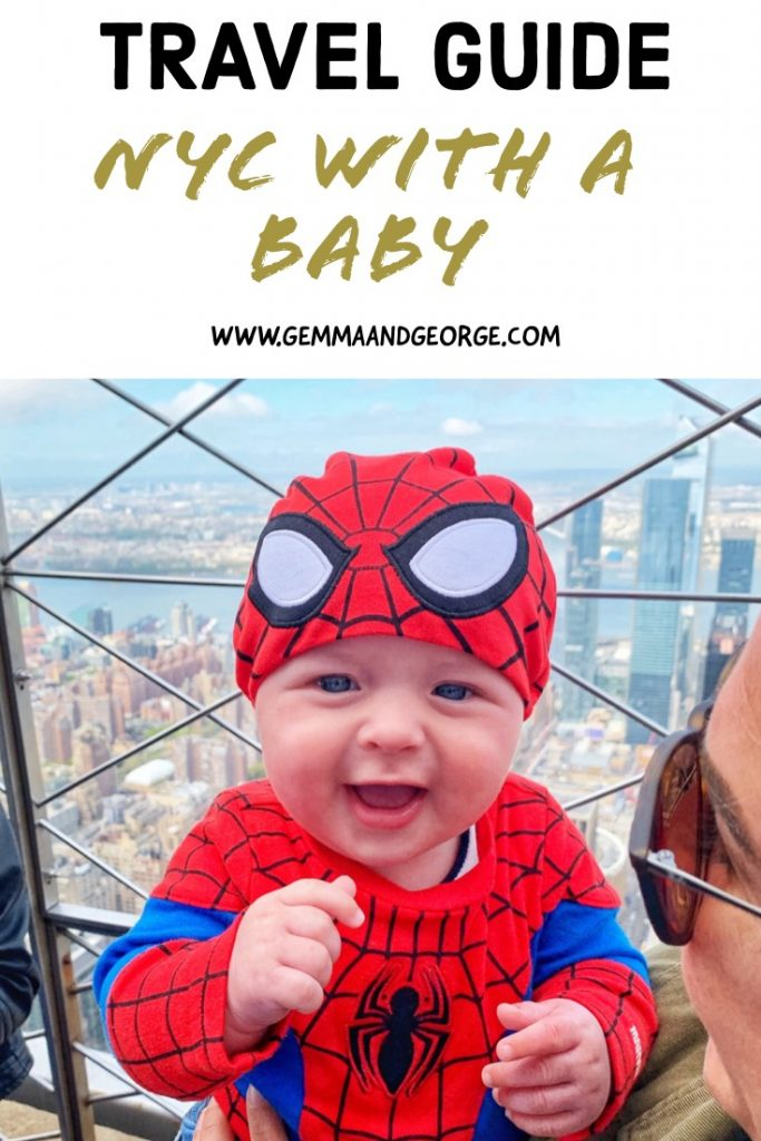 16 week old baby dressed as Spiderman at the top of the Empire State Building in New York City