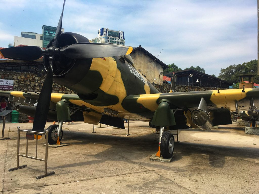 American fighter plane, in camo colours parked outside the War Remnants Museum in Ho Chi Minh City, Vietnam
