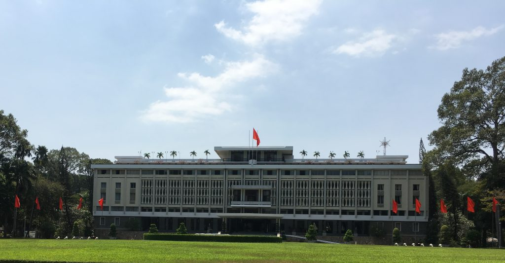 The independence palace in ho chi minh city, vietnam. A french building designed in the 1960s, the white walls and green garden look out of place among the chaos of this bustling city