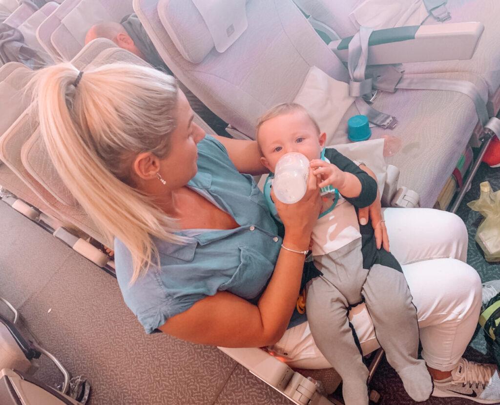 gemma feeding george on plane to dubai