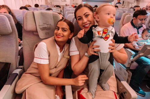 gemma and george, baby george playing with flight hostess on dubai flight